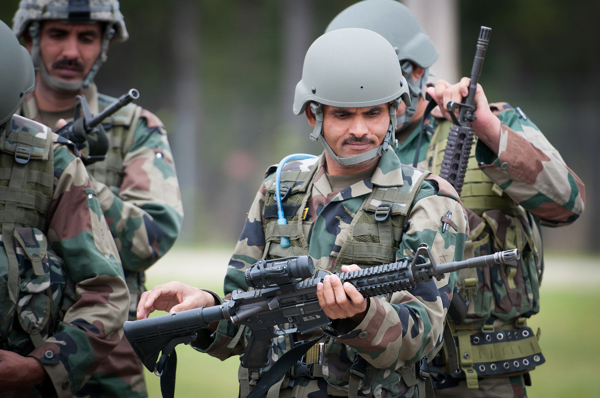 An_Indian_Army_paratrooper_with_the_50th_Independent_Para_Brigade_examines_an_M4_carbine_prior_to_sighting_in_the_weapon_at_Fort_Bragg_N.C.
